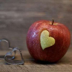 Apple with heart carved on it